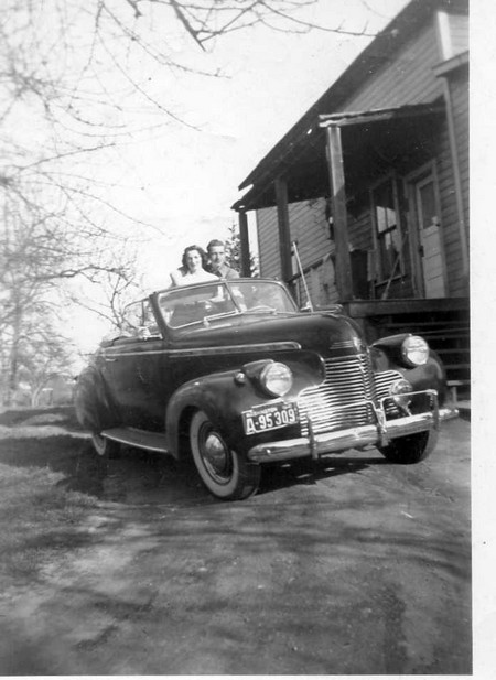 Art and Betty in their 1940 Chevy convertible behind the farmhouse, early 1940s