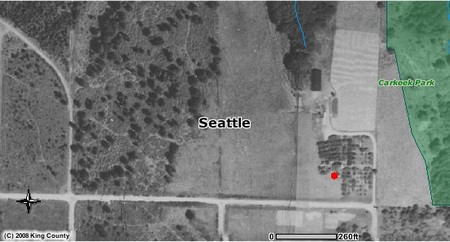 Aerial photo of the area from 1936.  Red dot indicates the location of the farmhouse.  The farm outbuildings, including the barn, can be also be seen to the north in this photo.