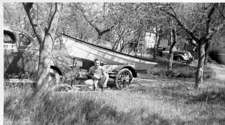Art with his boat in the orchard behind the farmhouse, early 1940s
